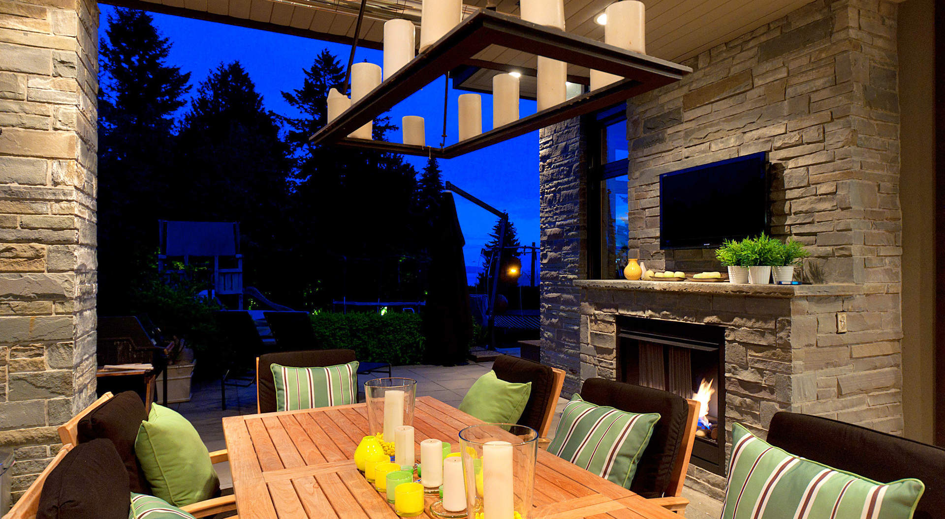 Covered Outdoor Living Area with BBQ Center and Fireplace