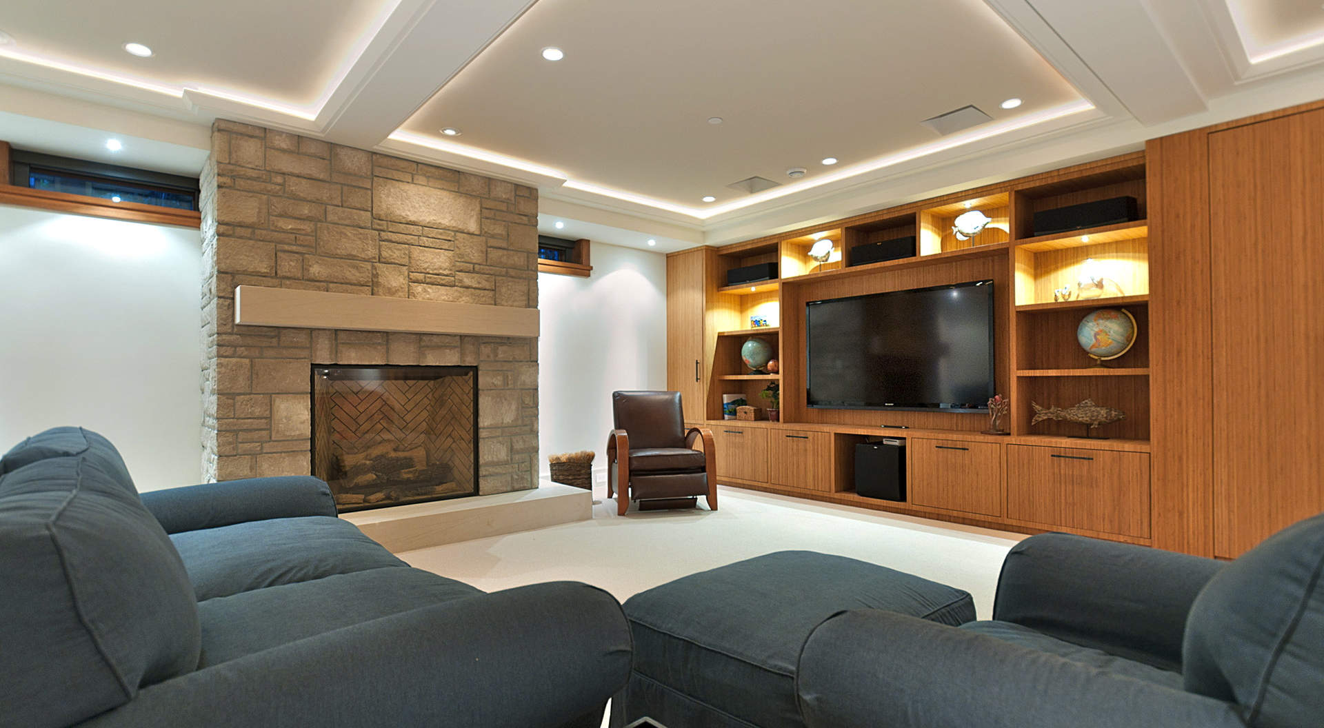 An Amazing Media Room with Fireplace & Custom Cabinetry