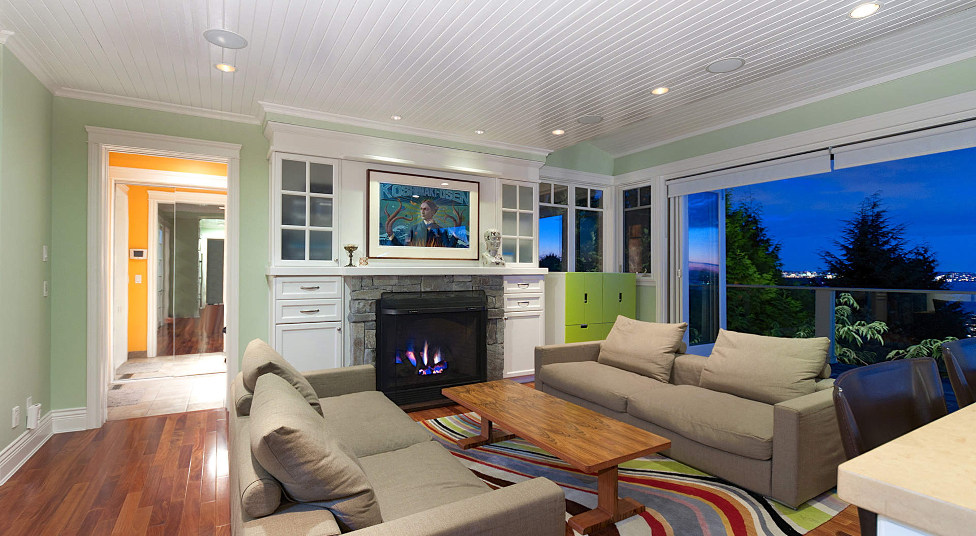 "Family Room with ""Eclipse"" Doors and Roaring Fireplace"