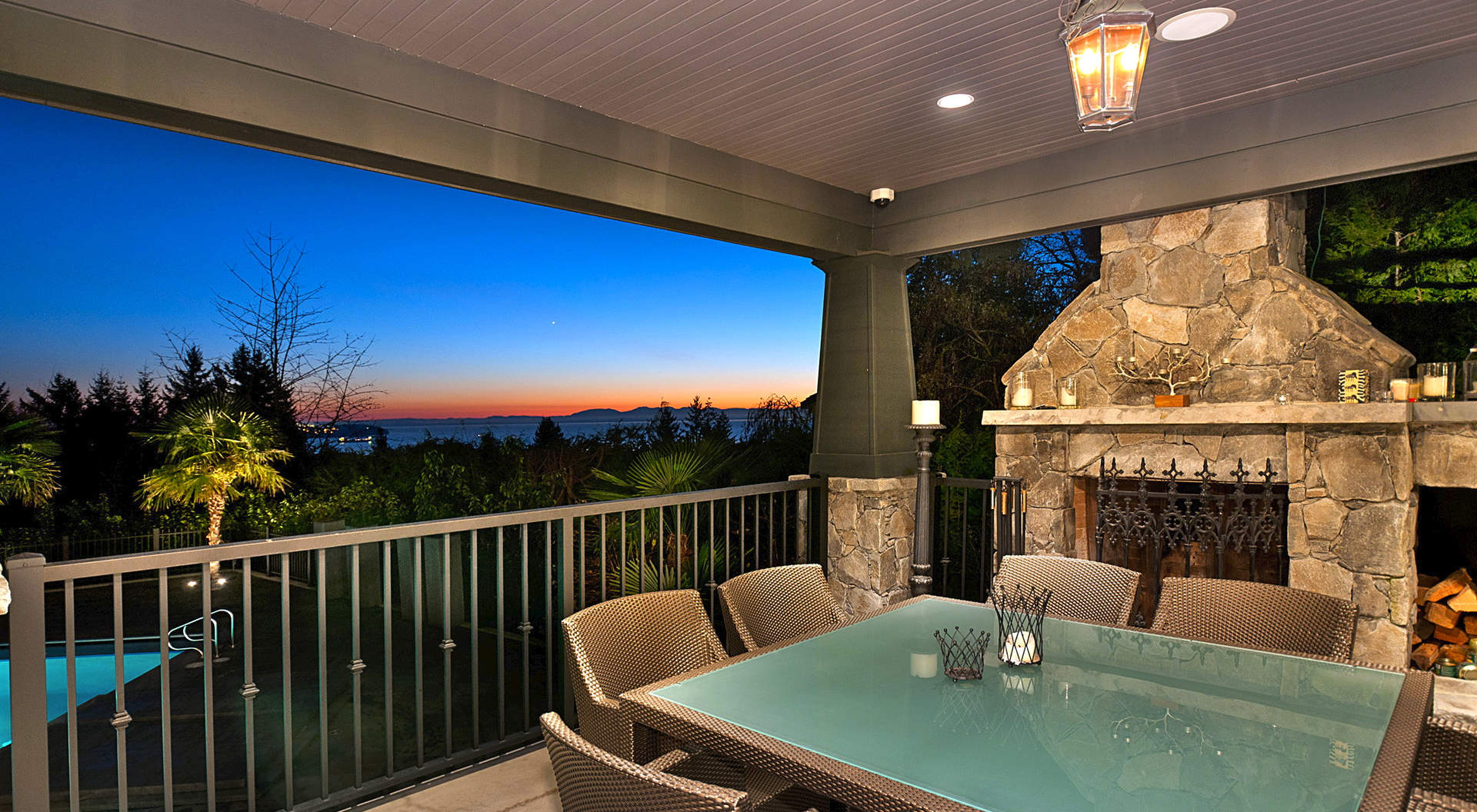Covered Terrace with Stone Fireplace