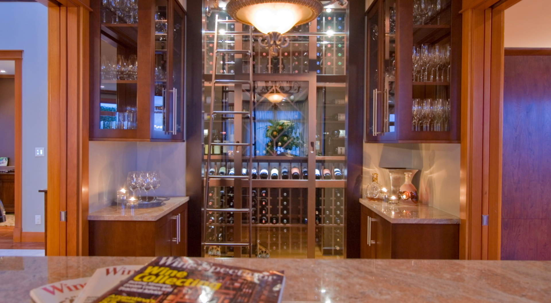 Main Floor Wet Bar with Refrigerated Wine Wall and Fully Stocked Prep Area