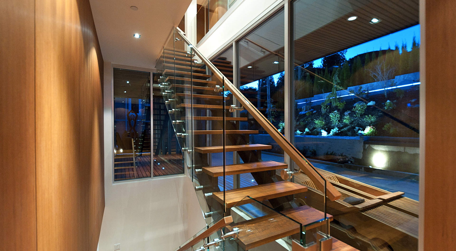 Custom Staircase Made of Glass, Steel, and Teak Treads